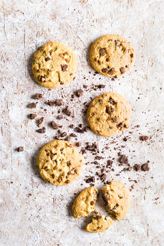 Some chocolate chip cookies isolated on delicate brown  background. Top view.