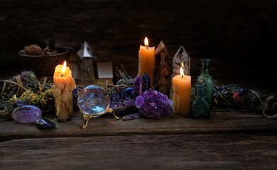 Candle and gemstones minerals on dark background. Crystals Stones minerals for Magic Rock Ritual, Witchcraft, spiritual practice. Esoteric, concept