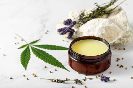 Composition with cannabis wax salve or hemp face body cream with  lavender extract and flowers