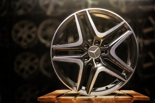 Krasnoyarsk, Russia, February 20, 2020: alloy wheels black original Mercedes Benz new, with a three-beam star. the original wheel