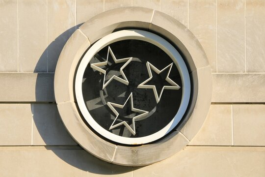 Nashville, Tennessee, United States. The flag of the state of Tennessee on a window inside the Bicentennial Capitol Mall State Park