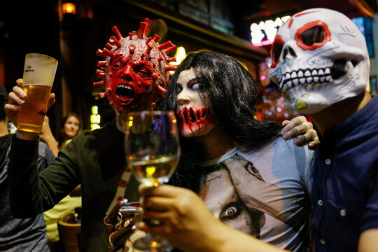 A man wears face mask depicting coronavirus as they celebrte Halloween at Lan Kwai Fong, a popular nightlife destination in Central, following the coronavirus disease (COVID-19) outbreak, in Hong Kong
