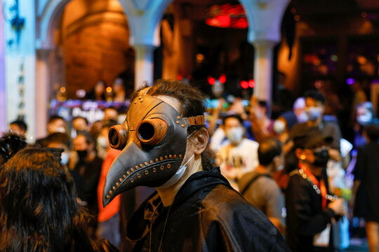 A man wearing a plague doctor mask celebrates Halloween at Lan Kwai Fong, a popular nightlife destination in Central, following the coronavirus disease (COVID-19) outbreak, in Hong Kong