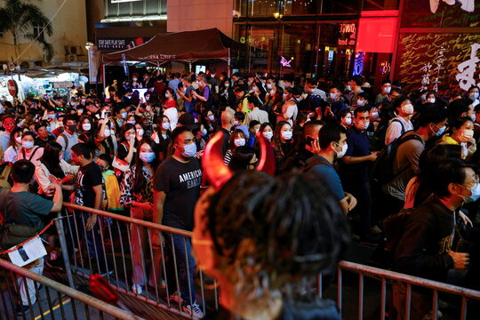 People wear protective face masks and costumes celebrating Halloween at Lan Kwai Fong, a popular nightlife destination in Central, following the coronavirus disease (COVID-19) outbreak, in Hong Kong