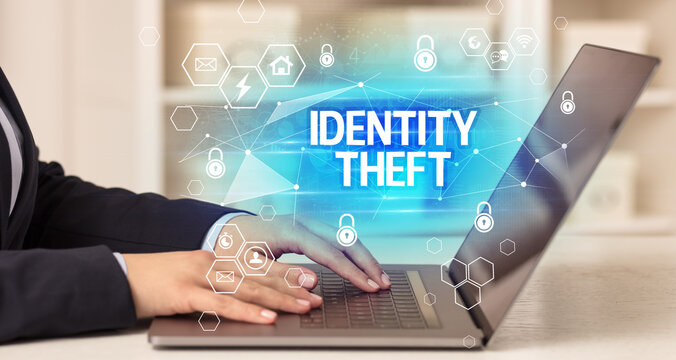 IDENTITY THEFT inscription on laptop, internet security and data protection concept, blockchain and cybersecurity