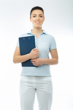 positive brunette doctor in white wearing with diary