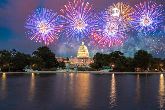 The United States Capitol building in Washington DC at night with fireworks