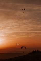 Fototapeta paralotnia, sport, nauka, zachód słońca, góry obraz