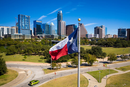 Texas flag in Front of Austin Texas downtown skyline