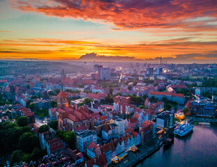 Aerial sunset view of the amazing old town and rivers of Gdansk with ships