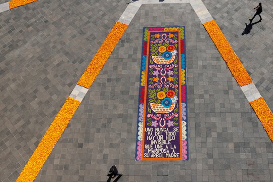 The main square of Mexico's Presidential Palace is decorated with cempasuchil or marigolds flowers to commemorate Day of The Dead in memory of the victims of the coronavirus disease (COVID-19) in Mexico City
