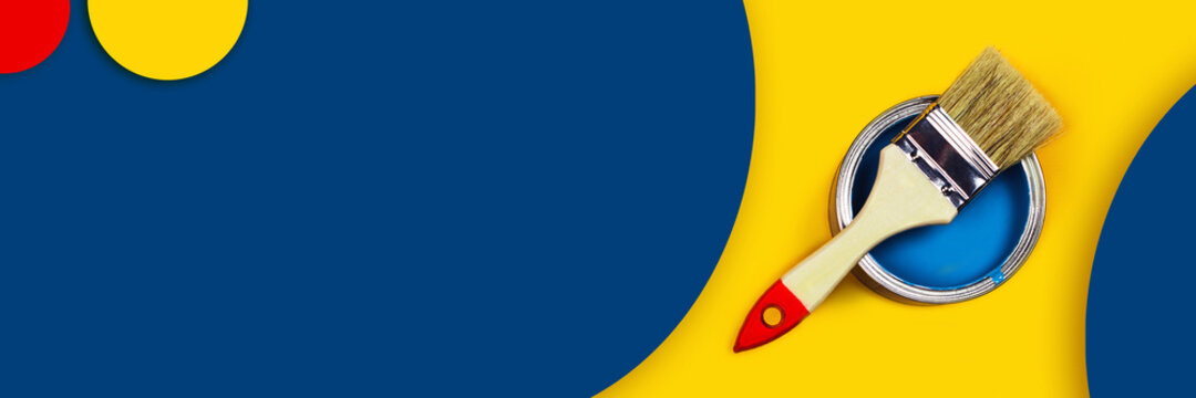 Abstract repair web-banner. One can of paint with a paintbrush on a yellow and classic blue background with colored circles made from paper.