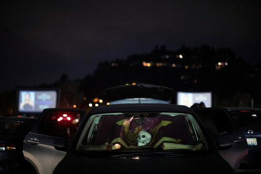 Halloween decorations are pictured on the dashboard of a car at  Joe Bob's Haunted Drive-In Halloween experience at Rose Bowl during the outbreak of the coronavirus disease (COVID-19), in Pasadena