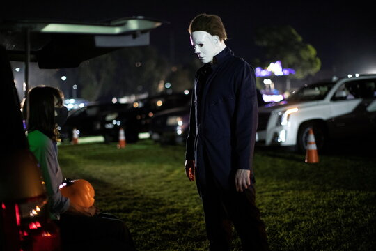 A person wearing a costume attends  Joe Bob's Haunted Drive-In Halloween experience at Rose Bowl during the outbreak of the coronavirus disease (COVID-19), in Pasadena