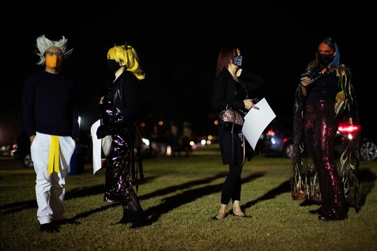 People wearing costumes and face protective masks attend  Joe Bob's Haunted Drive-In Halloween experience at Rose Bowl during the outbreak of the coronavirus disease (COVID-19), in Pasadena