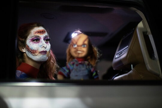 Shannon Haft, dressed like a character from Chucky, attends  Joe Bob's Haunted Drive-In Halloween experience at Rose Bowl during the outbreak of the coronavirus disease (COVID-19), in Pasadena