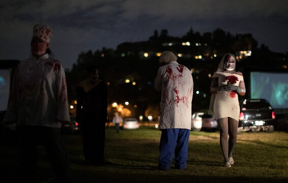 Performers dressed like zombies are pictured at  Joe Bob's Haunted Drive-In Halloween experience at Rose Bowl during the outbreak of the coronavirus disease (COVID-19), in Pasadena