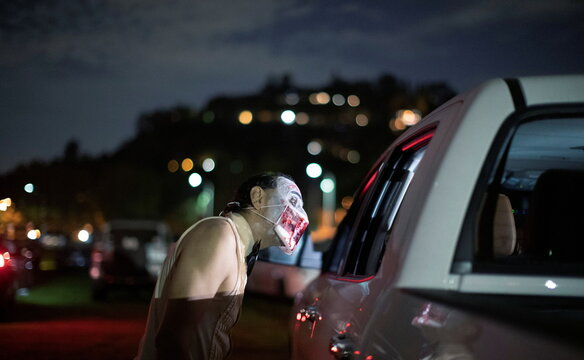 A performer dressed like a zombie is pictured at  Joe Bob's Haunted Drive-In Halloween experience at Rose Bowl during the outbreak of the coronavirus disease (COVID-19), in Pasadena