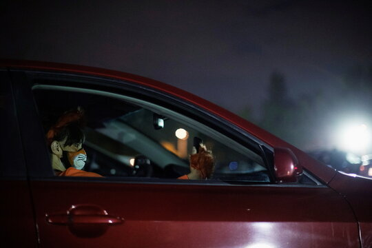 A person wearing a costume takes a selfie while attending  Joe Bob's Haunted Drive-In Halloween experience at Rose Bowl during the outbreak of the coronavirus disease (COVID-19), in Pasadena