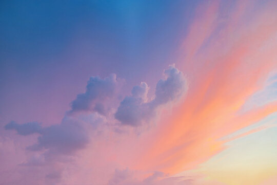 Clouds background with orange to purple gradient