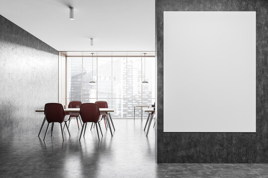 Mockup canvas in a dark grey office room, red chairs with tables on a dark floor
