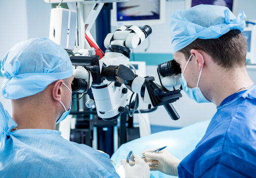 A team of surgeons performing brain surgery to remove a tumor.