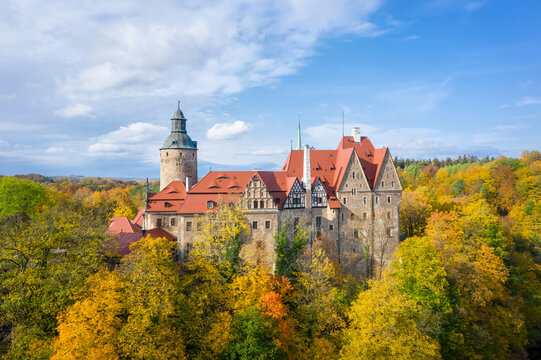 Aerial view of Czocha Castle surrounded by autumn yellow trees, Poland