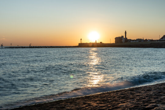 Sunset view of vlissingen, The Netherlands. the sun rising down with waves splashing.