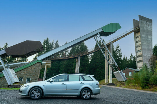 Johanngeorgenstadt, Saxony, Germany - october 22, 2020: a silver car in front of industrial design ski jump