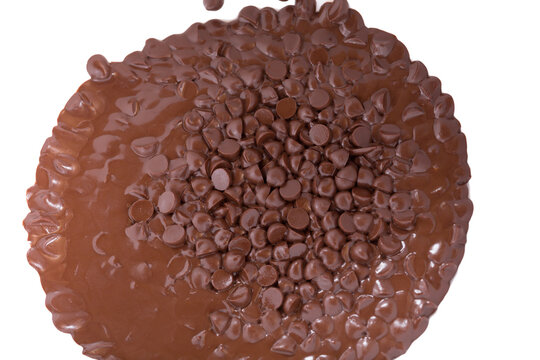 Dark chocolate granules in the melting process.