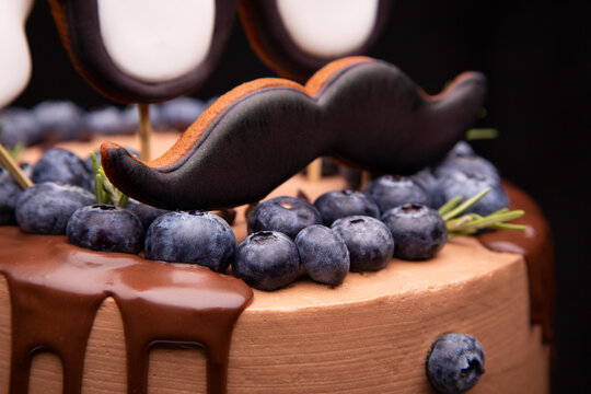 Chocolate cake close-up. Handmade cake. Chocolate cake with decorative elements and blueberries.