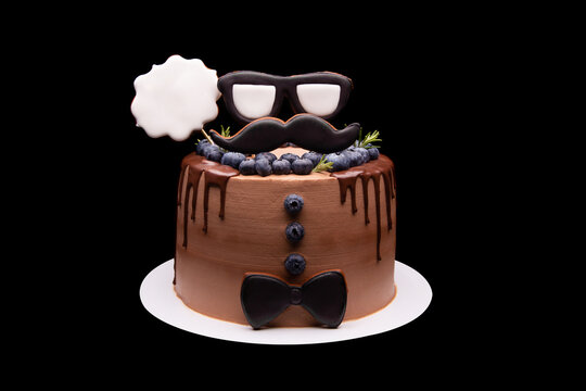 Handmade chocolate cake. Big chocolate cake in masculine style on a black background.