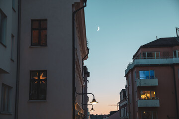 Evening street in Stockholm. Cozy winter atmosphere. Warm lighting Fotomurales