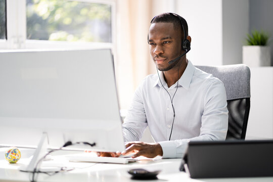 Business Service Agent With Headset At Computer