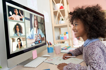 Cute african kid child girl distance learning during virtual distance online class on video...