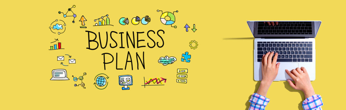 Business plan with woman using a laptop computer