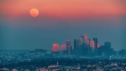 Fotobehang - Full moon rising above downtown Los Angeles skyline background. 4K UHD Timelapse