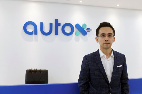 Jianxiong Xiao, founder and CEO of Alibaba-backed autonomous driving startup AutoX, poses for a photo at the company's office in Shenzhen