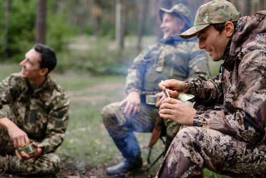 Picnic near Bonfire Happy Hunters Talk and Laugh.