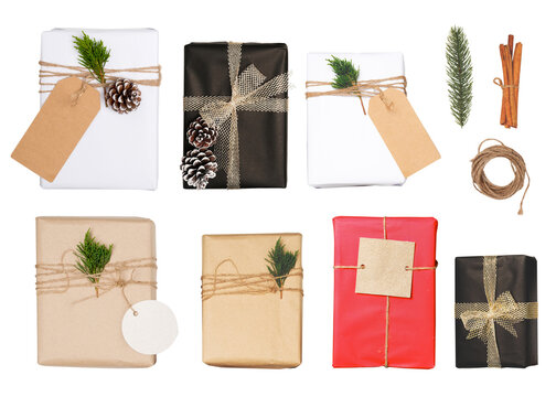 Christmas gift box with greeting tag - christmas present isolated on white background with clipping path for design. Merry Christmas and New Year holiday background. top view.