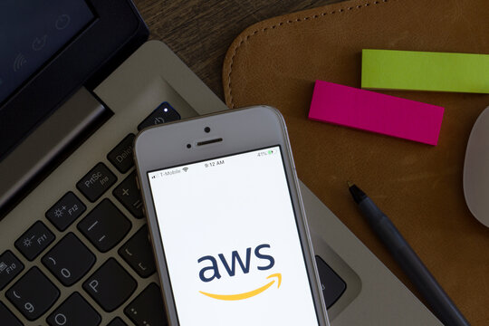 Portland, OR, USA - Apr 9, 2020: AWS management console mobile app welcome page is seen on a smartphone. AWS is a subsidiary of Amazon that provides on-demand cloud computing platforms and APIs.