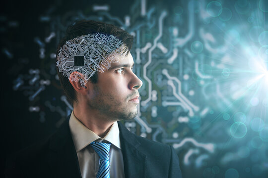Artificial intelligence concept. Electronic circuit in human brain. Side view of man looking to light.