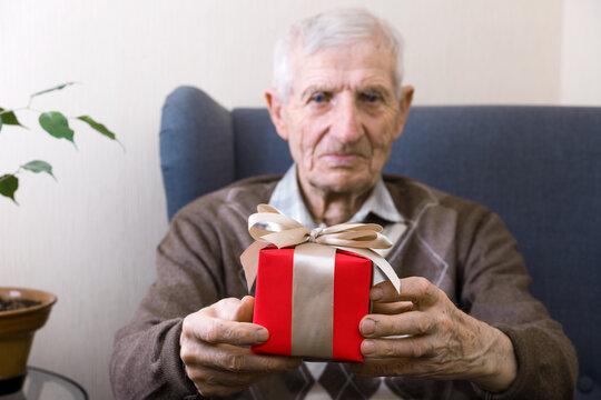 senior man and gift