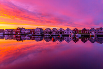 Idyllic boat houses in beautiful sunset