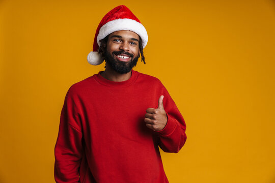 Happy young african american man in santa claus hat