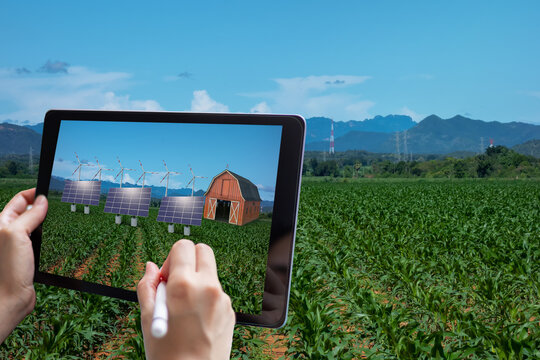 smart agriculture , industry 4.0, 5.0 technology concept. farmer use augmented mixed virtual reality technology to manage and simulation to install equipment in the farm predict, analytic how to fit