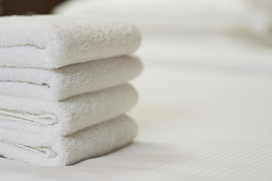 Fresh fluffy towels on the bed in apartments