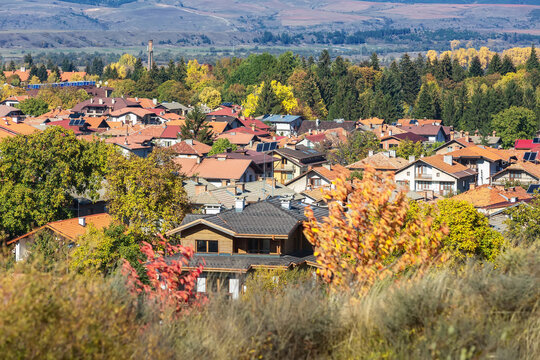 Bansko, Bulgaria old town aerial panorama with houses and colorful autumn trees