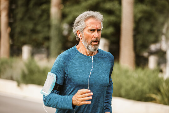 Active senior man jogging on a sunny day