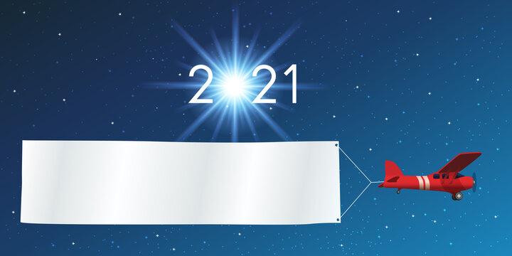Carte de vœux 2021 sur fond de ciel étoilé, avec un avion rouge tirant une banderole blanche pour écrire un message ou souhaiter ses meilleurs vœux pour la nouvelle année.